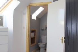 Storage in bathroom designed to your specifications by Expert Attics, Lucan, Dublin, Ireland.